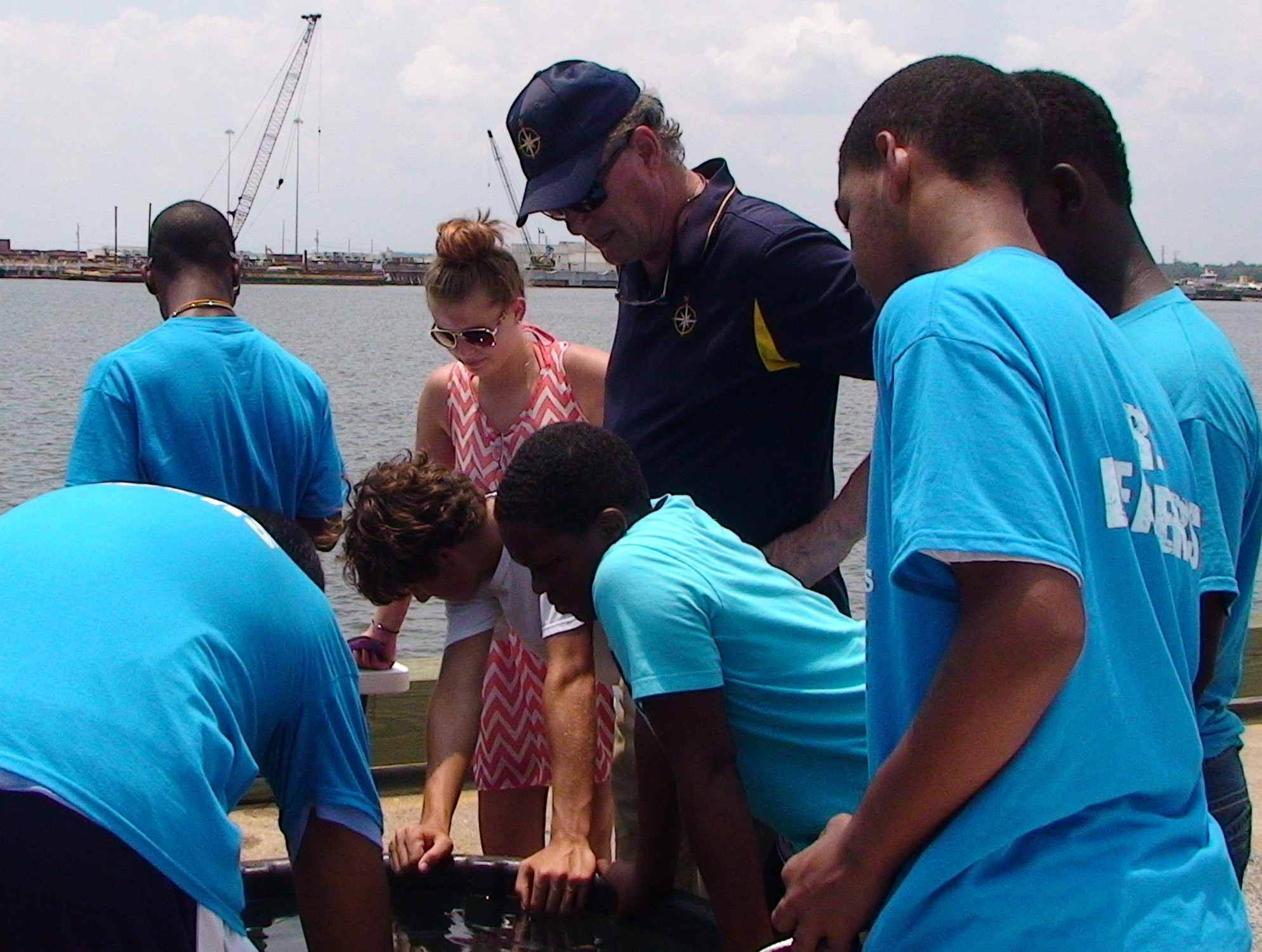<div style='color:#000000;'><br /><br /><h2>Gulfport, MS Media Day 2014. Dr. Bob Ballard (Nautilus Live and Ocean Exploration Trust) helps teach Boys and Girls club kids about ROVs (remotely operated vehicles). </h2>Photo courtesy of Gary Finch Productions</div>