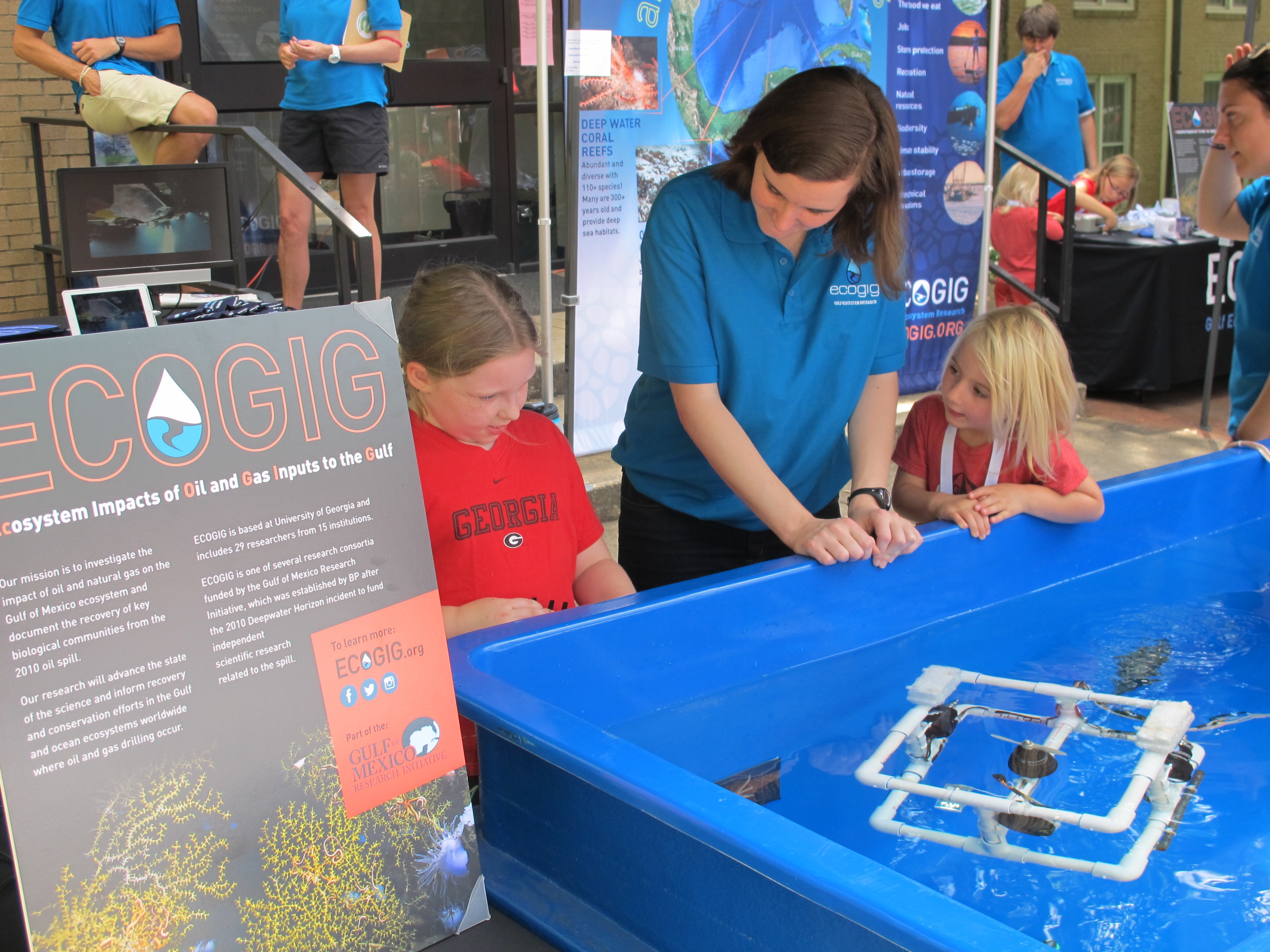 <div style='color:#000000;'><br /><br /><h2>2015 UGA football home game. ECOGIG graduate student Sarah Harrison shares her knowledge with visitors to the Ocean Discovery Zone before a University of Georgia home football game.</h2>(C)&nbsp;ECOGIG</div>