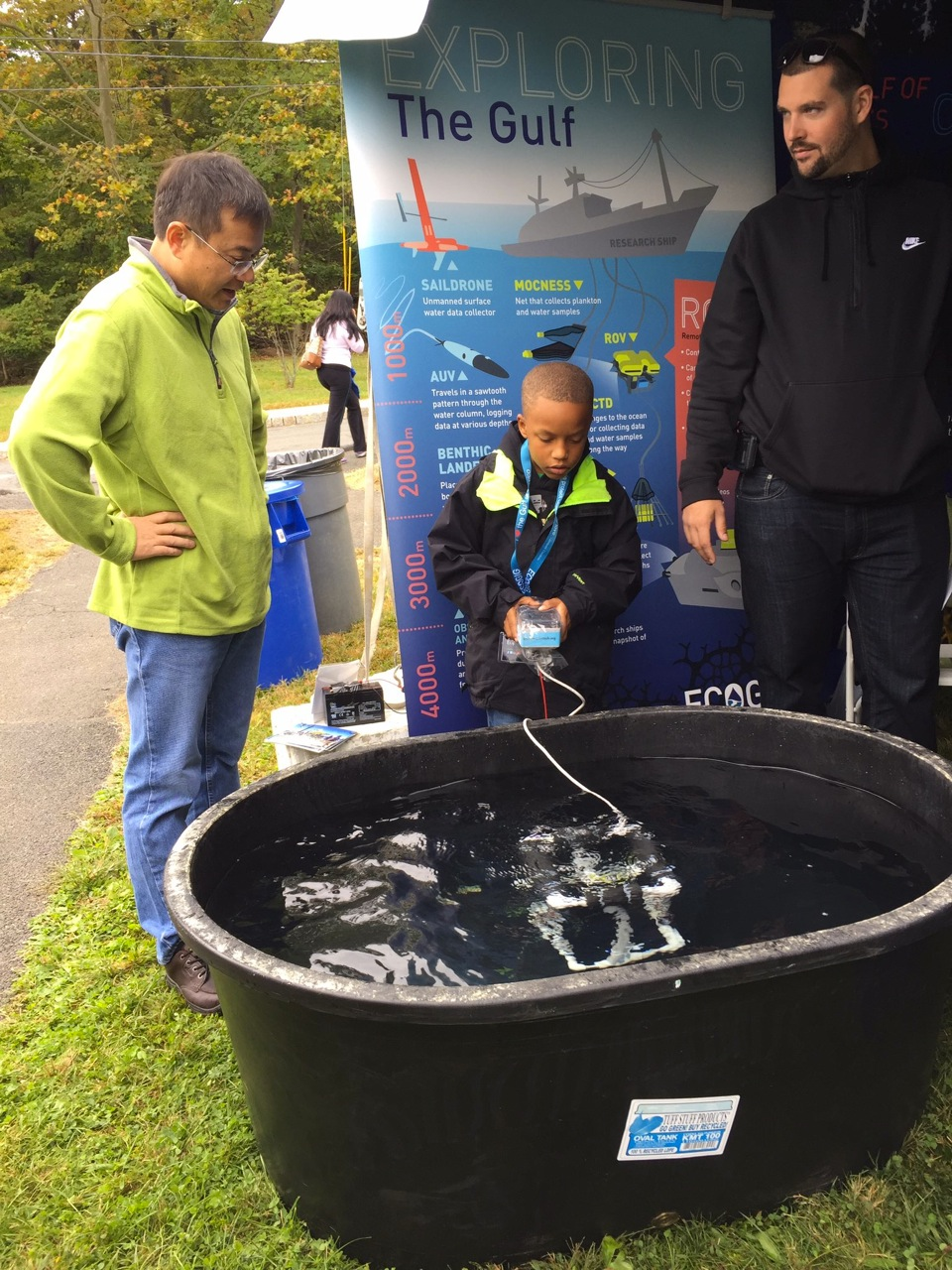 <div style='color:#000000;'><br /><br /><h2>2016 Lamont-Doherty Open House. Dr. Beizhan Yan talking with a couple of visitors to the Ocean Discovery Zone at Lamont-Doherty Earth Observatory's 2016 annual open house</h2>Photo courtesy of Kyle Frischkorn.</div>