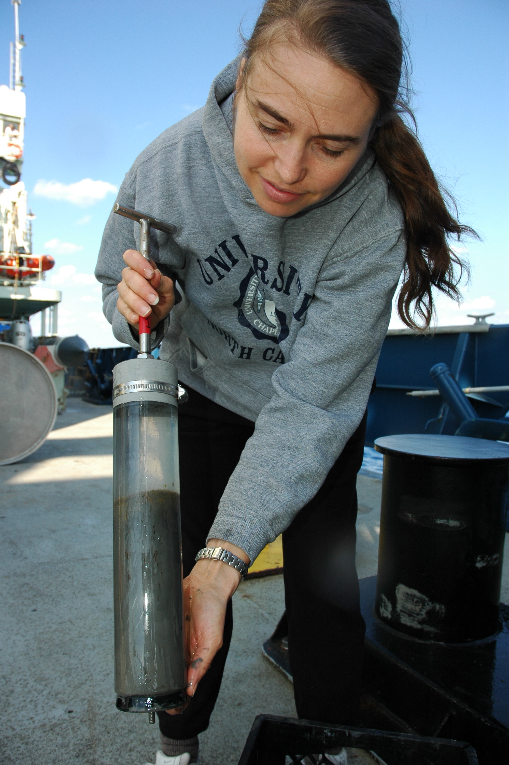 <div style='color:#000000;'><br /><br /><h2>Dr. Samantha Joye shows off a push core from the ALVIN, full of deep sea mud.</h2>(C) ECOGIG</div>