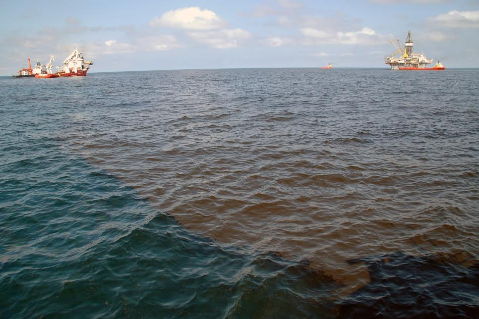 Image showing a thick oil slick about 5 miles from the Macondo wellhead in May 2010, photo credit Luke McKay, UNC-CH.)